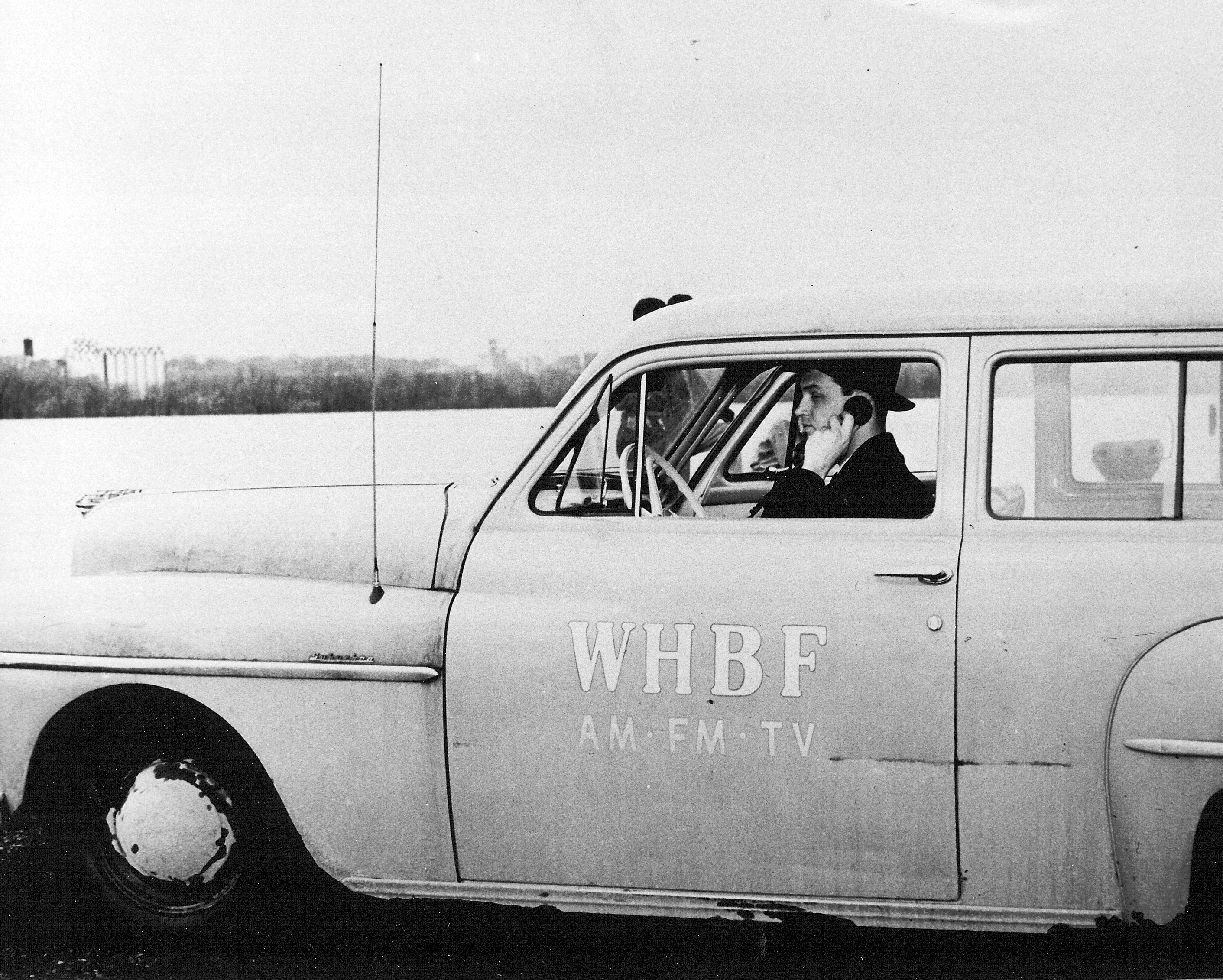 WHBF-TV_Reporter_Charles_Harrison_with_News_Car.jpg